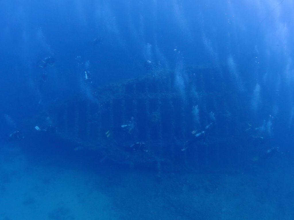 Carnatic wreck with divers, Red Sea, Egypt