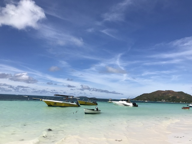 dive boats in the bay at Cote D'Or, Praslin Island, Seychelles