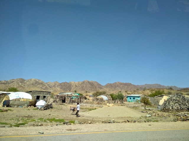 Afar village with traditional round temporary houses and more recent permanent buildings, Ethiopia