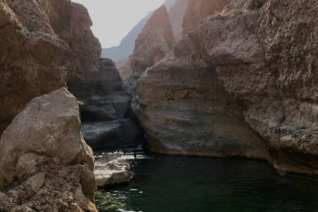 The last pool with the entrance to the cave in Wadi Shab, Oman